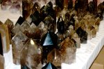 Polished smoky quartz crystals in display