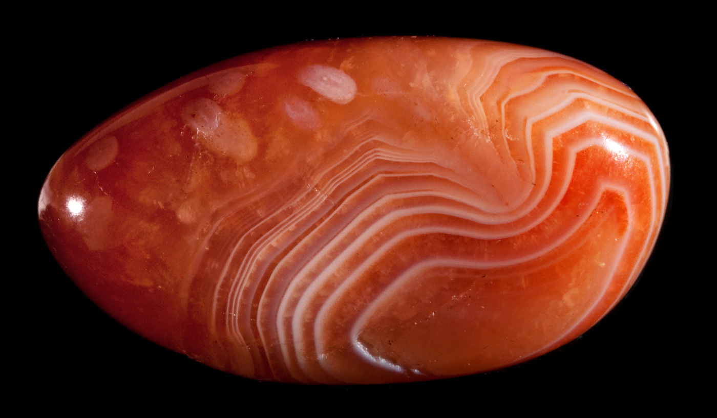 Polished oval red lace agate